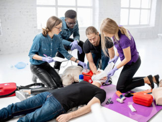 group of people doing first aid to a man