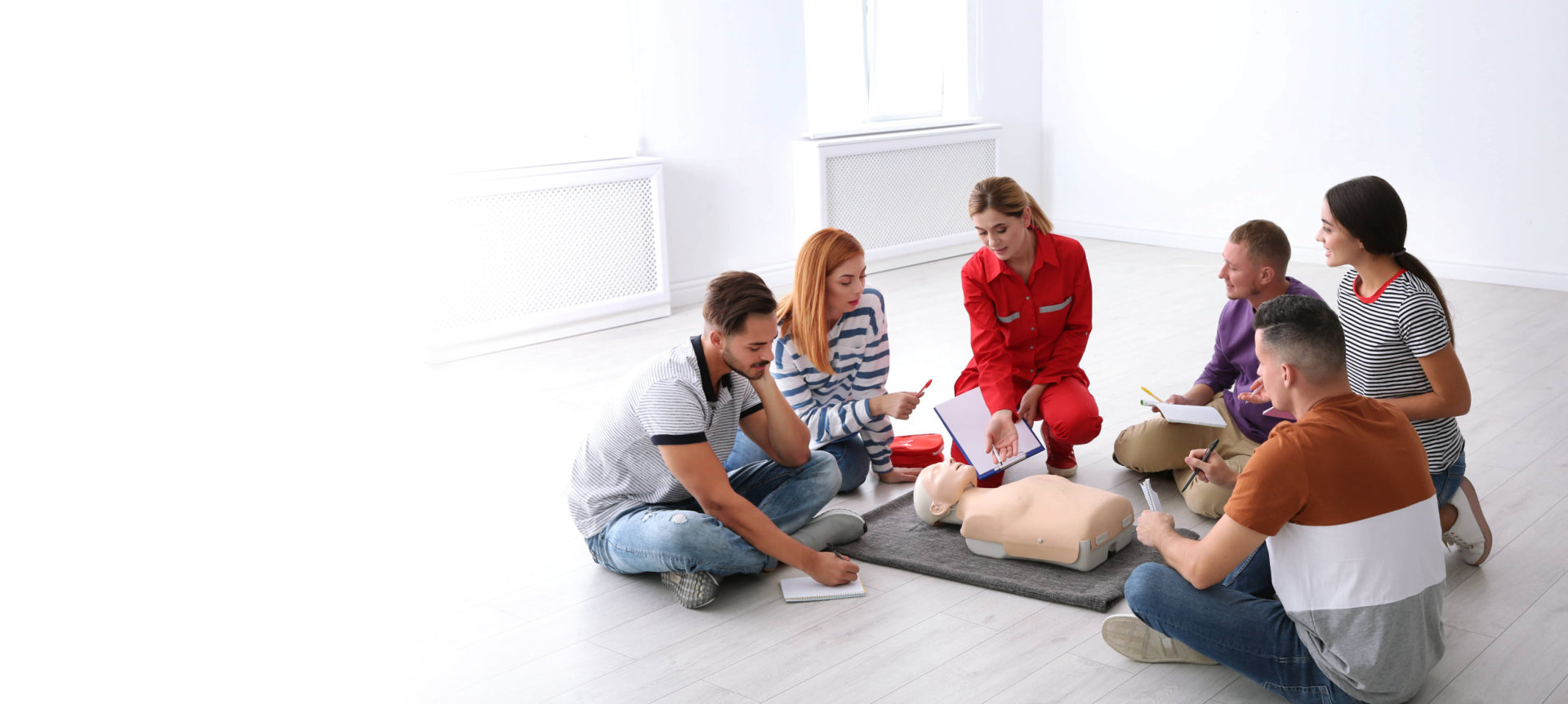 a woman explaining about first aid
