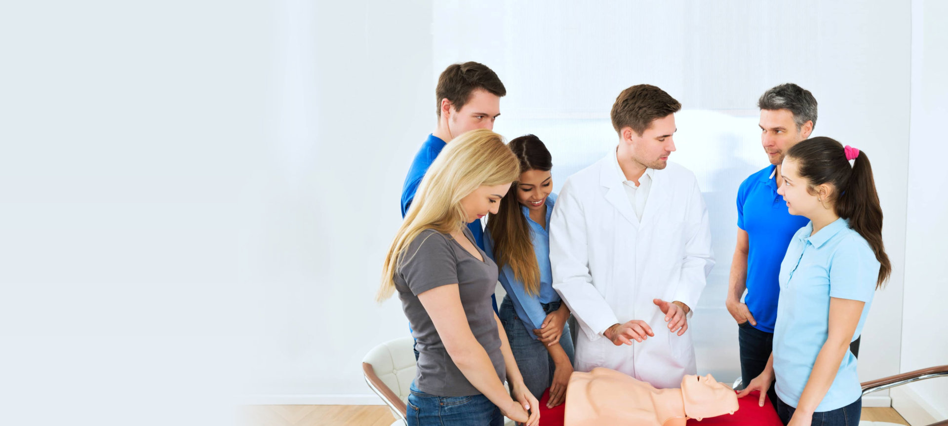 group of people listening to a medical worker